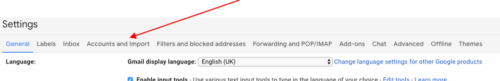 Arrow pointing at Gmail accounts and import tab in settings