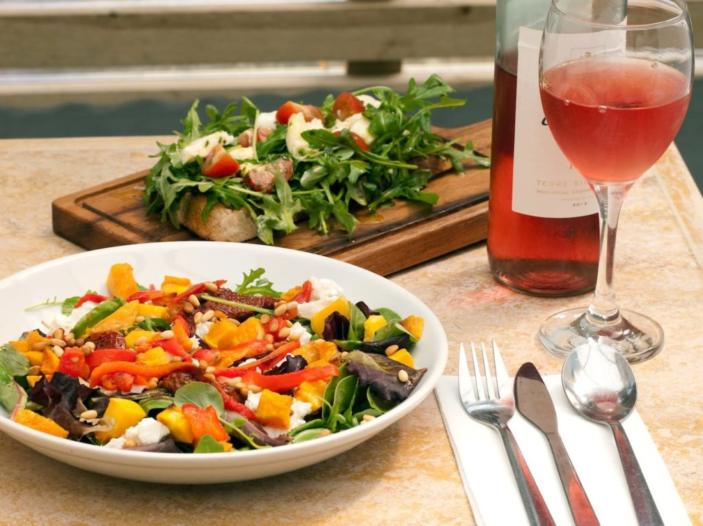 Food website photography: italian salad and rose.