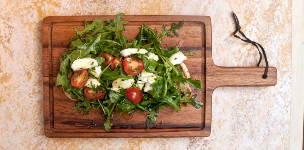 Food website photography: Italian salad on wooden board