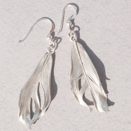 Website photography example: Silver earrings in bright sunlight